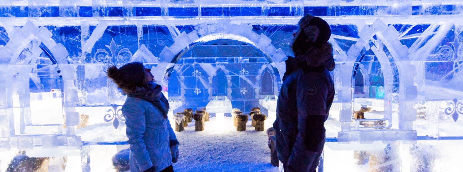 Couple admiring ice sculptures in SnowExperience365